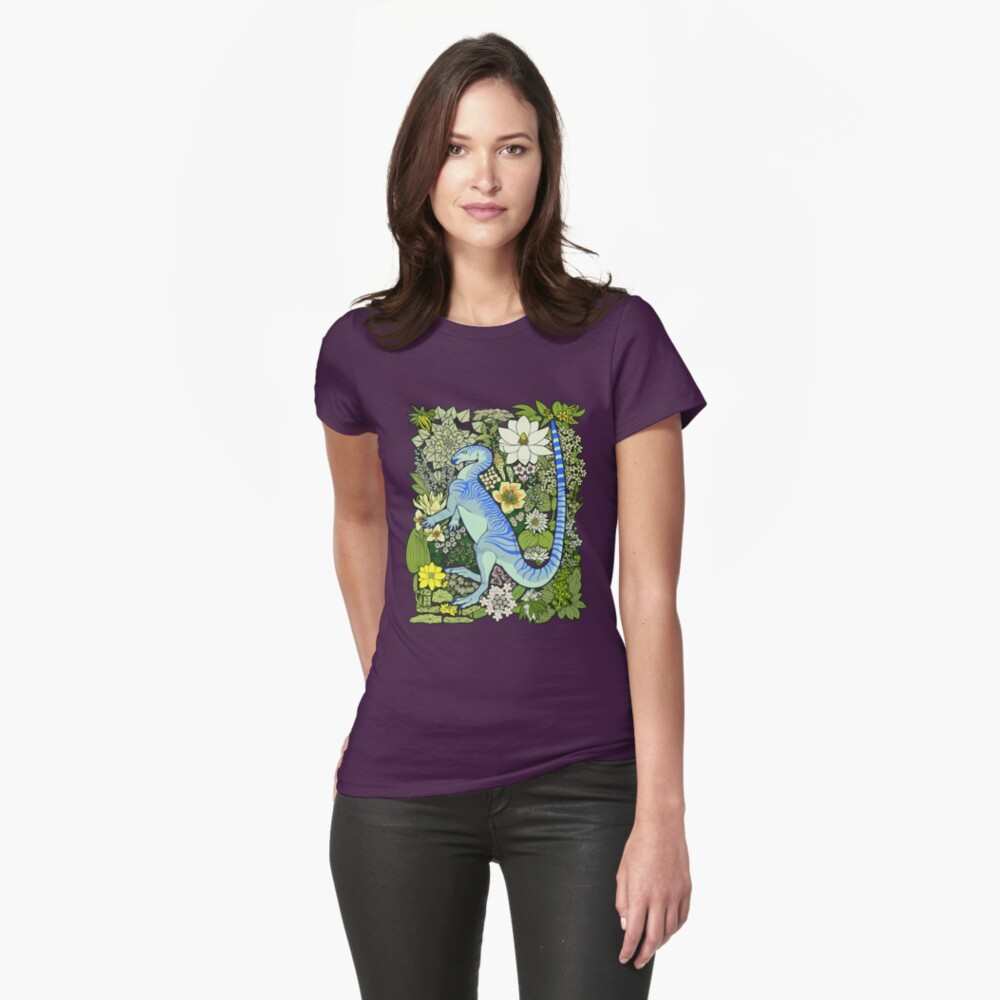 Model wearing Raven Amos' t-shirt of Parksosaurus amid prehistoric plants