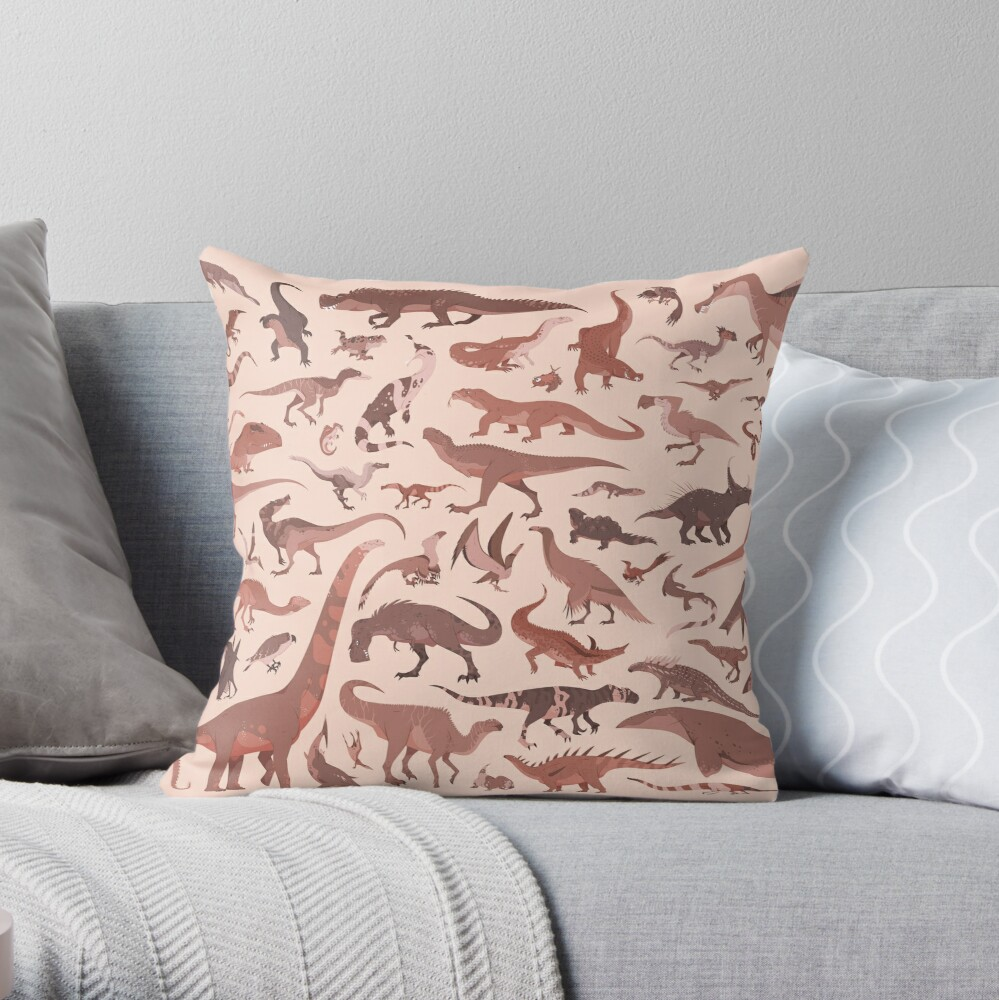 A pillow decorated with a pattern of various prehistoric animal illustrations.